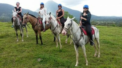 horseback riding with a short naturalist hike to La fortuna waterfall and the best whitewater rafting tour in arenal volcano